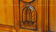Detail of an engraved in wood piece of furniture at a B&B in the cognac vineyard ideal for cognac lovers