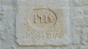 Engraved stone recalling the date of construction of the B&B with craft cognac distilleries as neighbours